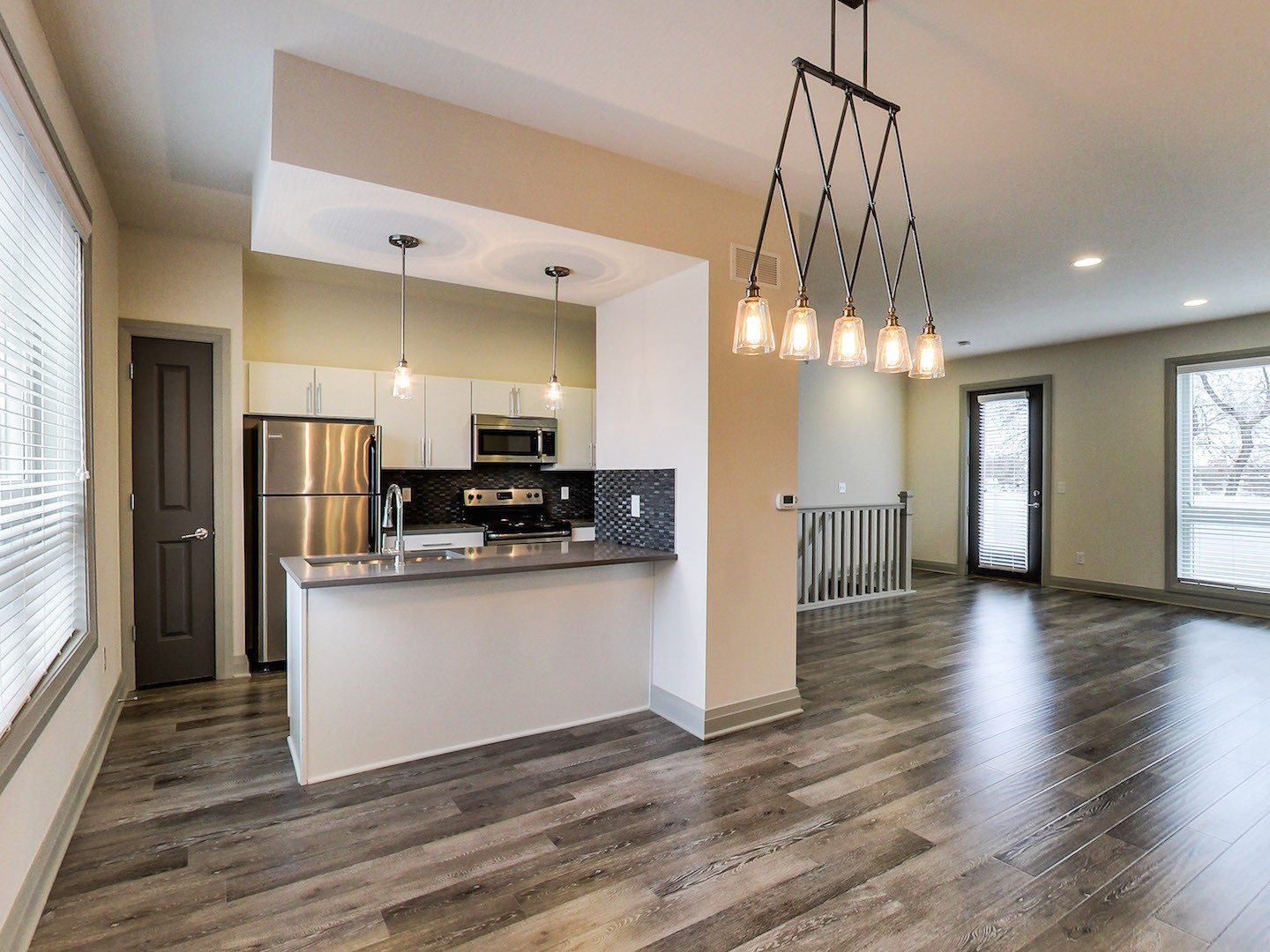 40 West Apartments Columbus Ohio | Short North Rentals | Penthouse 2 Bedroom Kitchen and Living Area