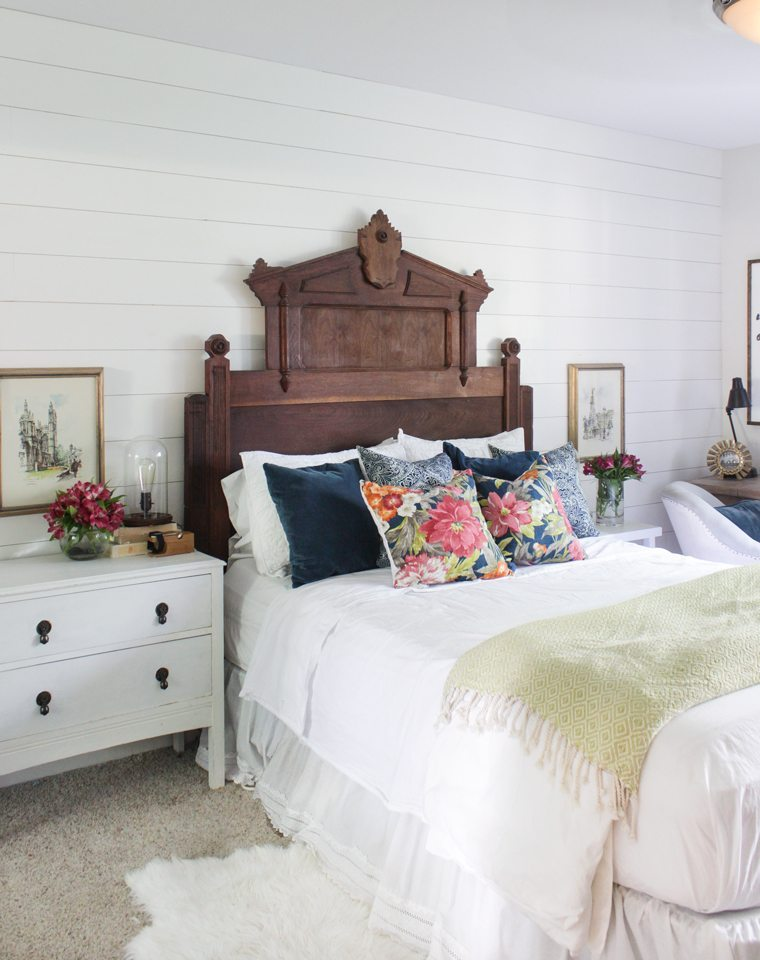 Big, Bold Floral Decor | Design Inspiration | Blue and White Bedroom With Floral Pillows