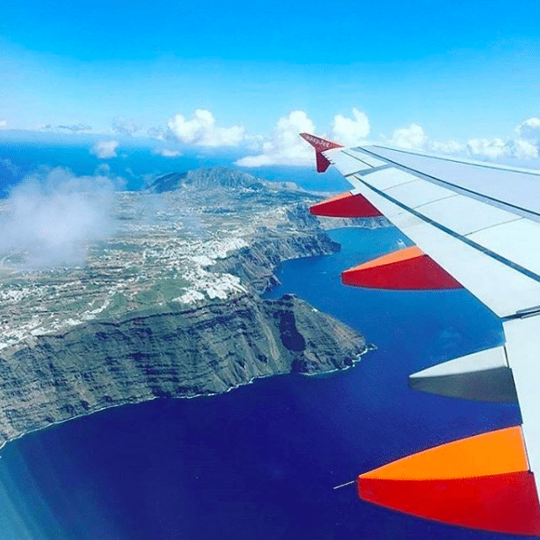 The Instagrammers Guide To Santorini, Greece | Photo-Ops in Santorini, Greece | Airplane views